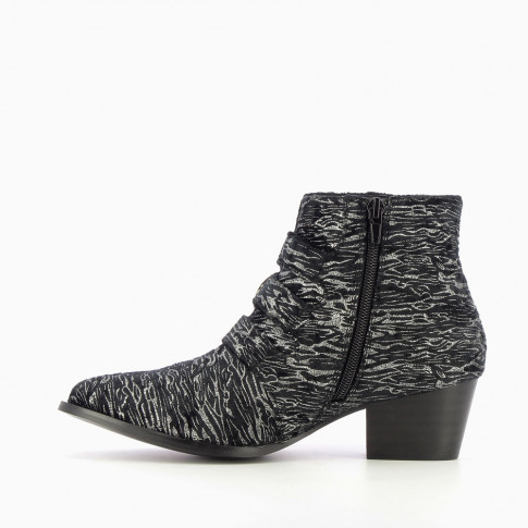Zebra-print ankle boots with western buckle