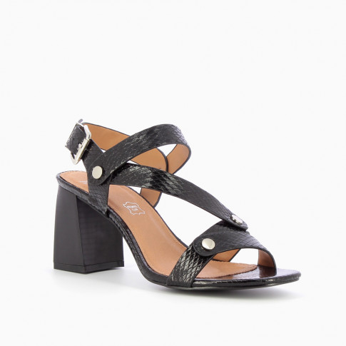 Black snakeskin effect sandals with riveted straps