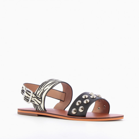 Black and zebra-print sandals with conical studs
