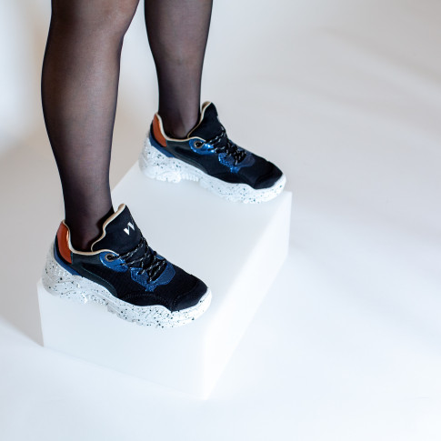 Black and blue sneakers with large galaxy-print sole