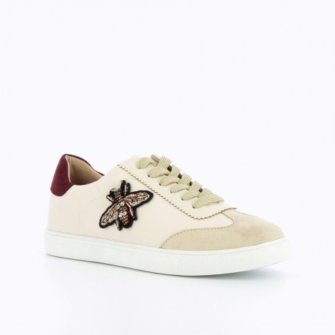 Beige sneakers with bee-shaped jewellery