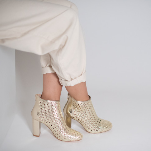 Gold openwork ankle boot with heel