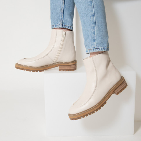 Light beige ankle boots with topstitch and serrated sole