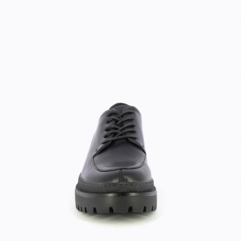 Black brogues with large scalloped sole