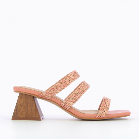 Pink mules with pyramid heel