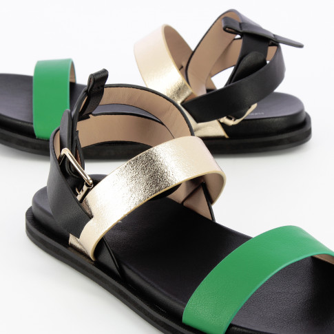 Black flat sandals with gold and green straps